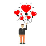 Man holding a balloon in the form of heart.Freedom concept. Stock Photos