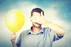 A man holding a balloon Stock Photo