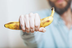Man holding banana. Royalty Free Stock Photography