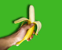 A man holding a banana in hand Royalty Free Stock Images