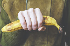 Man holding banana in his hand Royalty Free Stock Photo