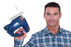 Man holding band-saw Royalty Free Stock Images
