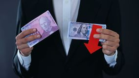 Man holding banknotes, dollar falling relative swiss franc, financial forecast. Stock footage stock video footage