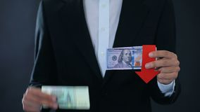 Man holding banknotes, dollar falling relative to russian ruble, stock market stock video footage