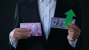 Man holding banknotes, dollar growing relative swiss franc, financial forecast. Stock footage stock footage