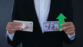 Man holding banknotes, dollar growing relative to Japanese yen, stock market stock footage