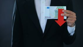 Man holding banknotes, euro falling relative to swiss franc, financial forecast. Stock footage stock footage