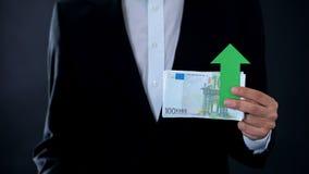 Man holding banknotes, euro growing, financial forecast, strong world economy. Stock photo stock photos