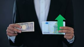 Man holding banknotes, euro growing relative japanese yen, financial forecast. Stock footage stock video