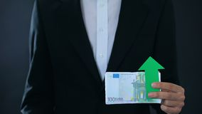 Man holding banknotes, euro growing relative to swiss franc, financial forecast. Stock footage stock video