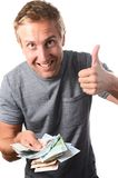 Man holding banknotes with the thumbs up gesture Stock Photo