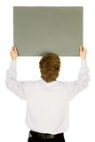 Man holding banner add. Rear view Royalty Free Stock Image