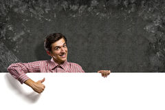 Man holding a banner Royalty Free Stock Photo