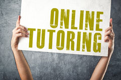 Man holding banner with ONLINE TUTORING title Stock Images