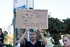 Man holding a banner at a protest in Bucharest Royalty Free Stock Photography