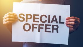 Special offer banner. Man holding banner with Special offer text printed stock photos