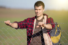 Man holding barbed wire fence Royalty Free Stock Image
