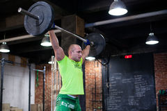Man is holding the barbell over the head Royalty Free Stock Photos