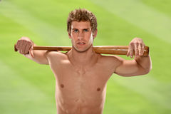 Man Holding Baseball Bat on Shoulders Stock Image