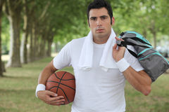 Man holding a basket ball Stock Image