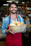 Man holding basket of bread Stock Photography
