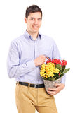 Man holding a basket with flowers Royalty Free Stock Images