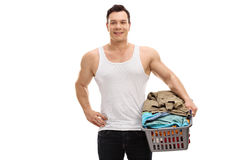 Man holding a basket full of clothes Stock Photos