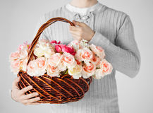 Man holding basket full of flowers Royalty Free Stock Photo