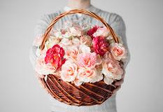 Man holding basket full of flowers Royalty Free Stock Images