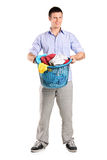 Man holding a basket full of laundry Stock Photography