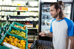Man holding basket while shopping Royalty Free Stock Image