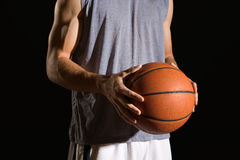 Man holding a basketball Stock Images