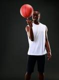 Man holding a basketball on his finger Stock Photos