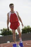 Man Holding Baton On Racing Track Royalty Free Stock Image