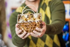 Man Holding Bauble Basket In Store Royalty Free Stock Image