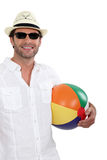 Man holding beach ball Royalty Free Stock Photo