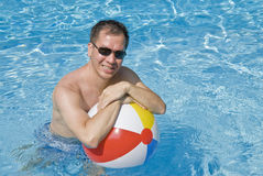 Man Holding Beach Ball in the Swimming Pool Royalty Free Stock Images