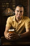 Man holding beer. stock image