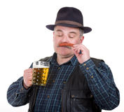 Man holding a beer belly and sausage Royalty Free Stock Images