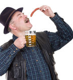 Man holding a beer belly and sausage Royalty Free Stock Photos