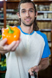 Man holding bell pepper Stock Photos