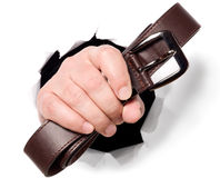 Man is holding belt in his fingers through a hole Stock Images