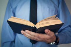 Man holding bible. stock photography