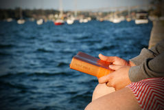 Man holding bible in hands. Man holding NIV bible in hands close up by the sea close up in casual outfit stock photography
