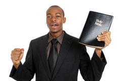 Man holding a bible preaching the gospel. This is an image of a man holding a bible preaching the gospel Royalty Free Stock Images