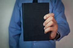 Man holding bible. royalty free stock image