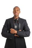 Man holding a bible showing commitment. This is an image of a man holding a bible showing commitment Royalty Free Stock Photo