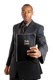 Man holding a bible showing commitment Stock Photos