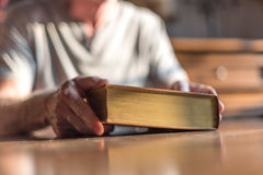 Man holding the Bible Royalty Free Stock Photography