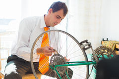 Man Holding Bicycle Wheel Royalty Free Stock Images